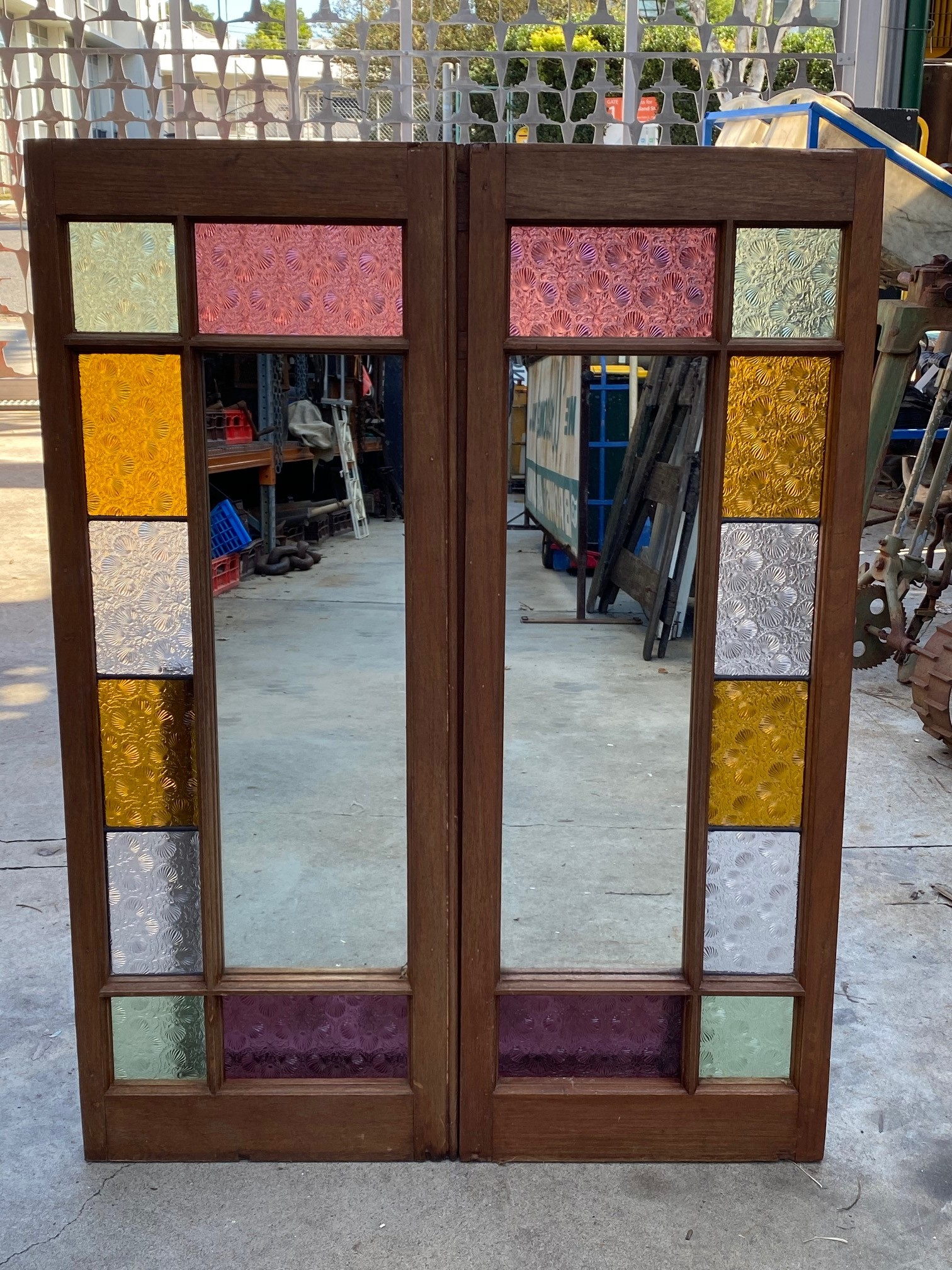 Coloured glass and mirrored window feature piece